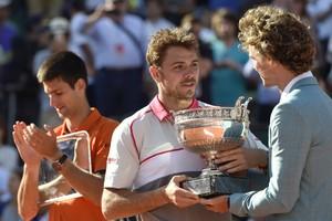 Novak Djokovic, Stan Wawrinka en Gustavo Kuerten © AFP