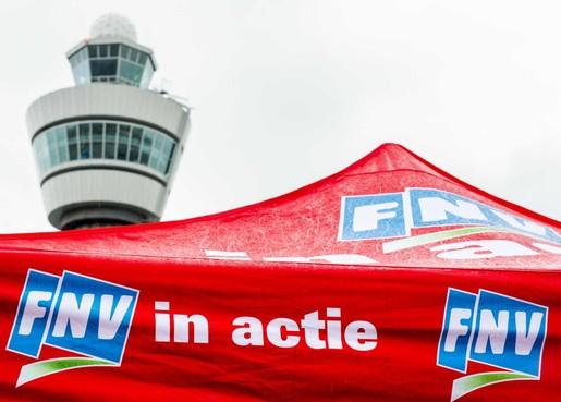 Schiphol sleept FNV voor de rechter om acties
