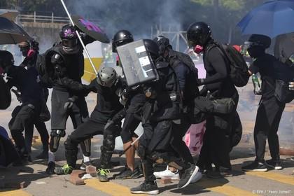 Politie Hongkong dreigt met scherp te schieten